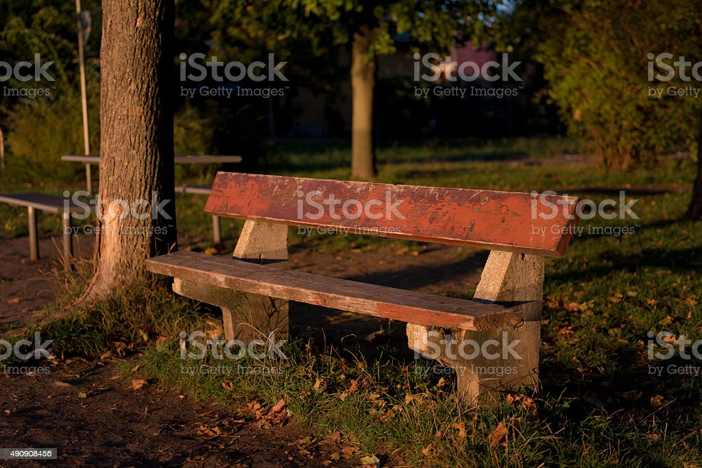 Empty bench in romantic sunset stock photo