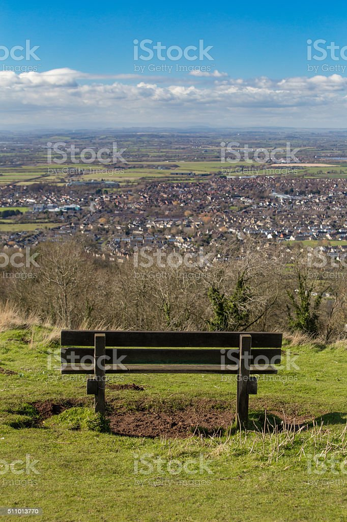 Empty bench, looking over the stunning view from Cleeve Hill stock photo