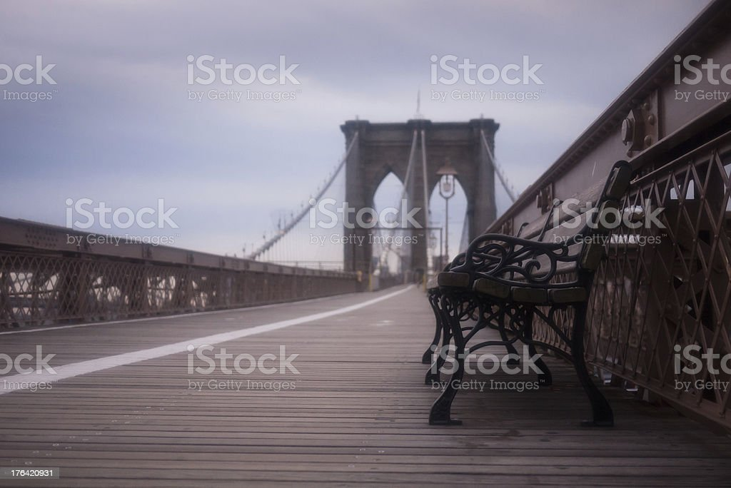 Empty Bench on Brooklyn Bridge in New York City royalty-free stock photo