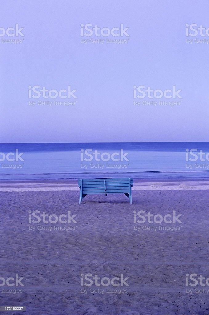 empty bench on the beach stock photo
