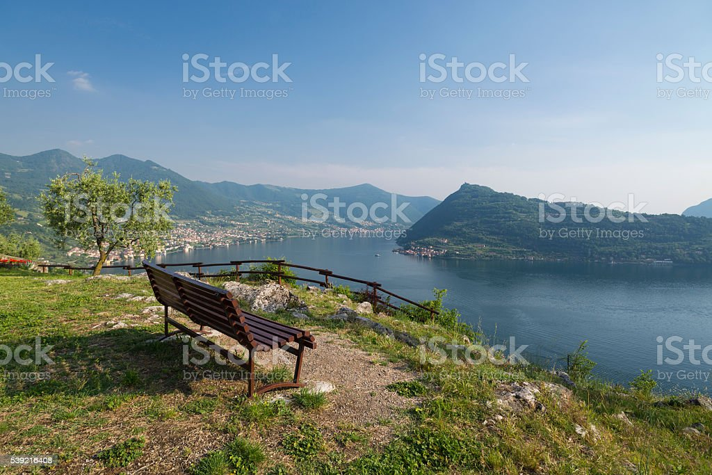 Empty bench with panorama of Lake Iseo and Monte Isola stock photo