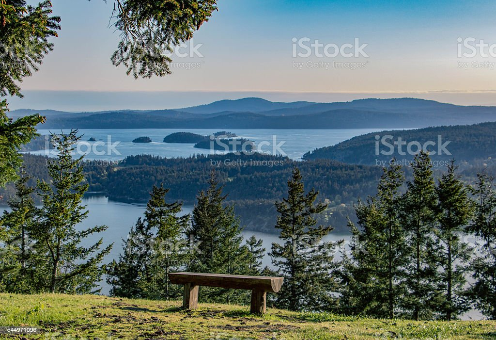 Empty bench with panoramic view of many islands stock photo