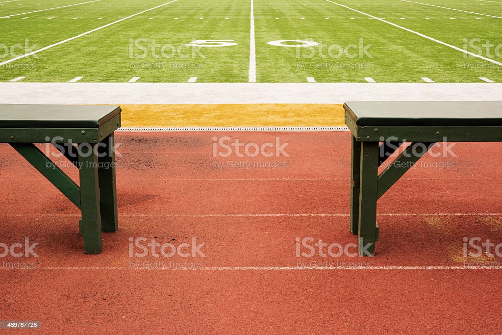 Empty Benches at the Fifty Yard Line stock photo