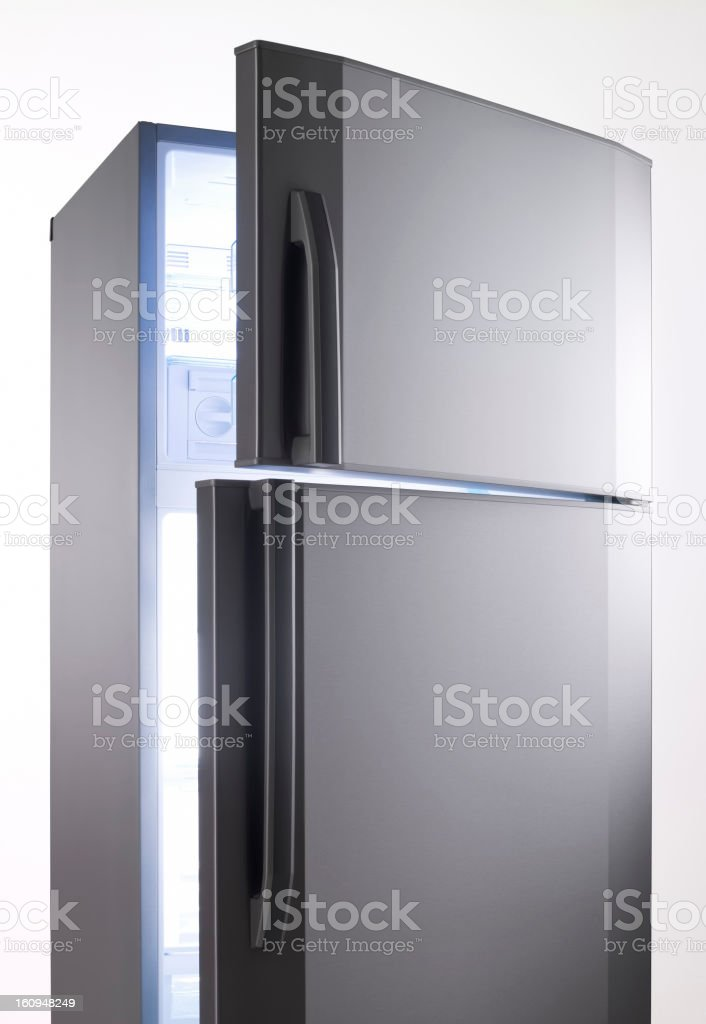 empty big fridge with blue lights stock photo