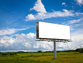 Empty billboard in front ofcloudy sky in a rural location