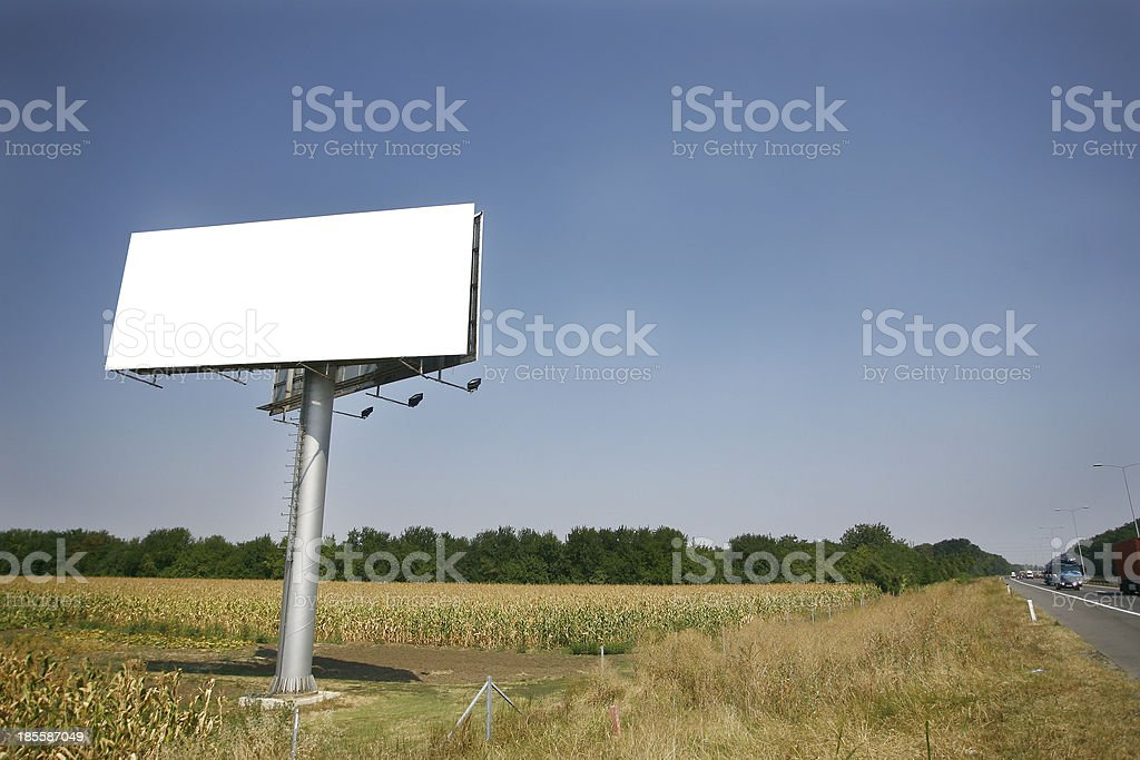 Empty billboard on background of sunset sky royalty-free stock photo