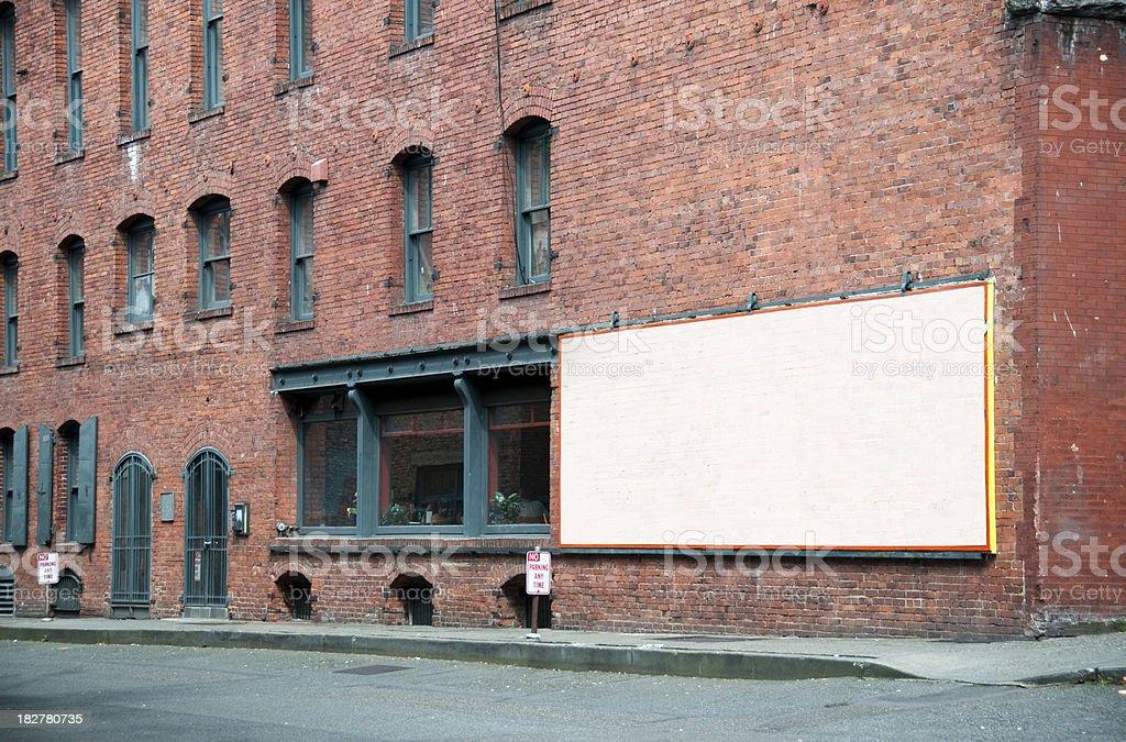 Empty Billboard on rustic brick building (Seattle, USA) royalty-free stock photo