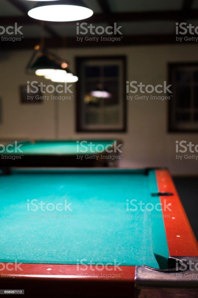 Empty billiard table under the lights stock photo