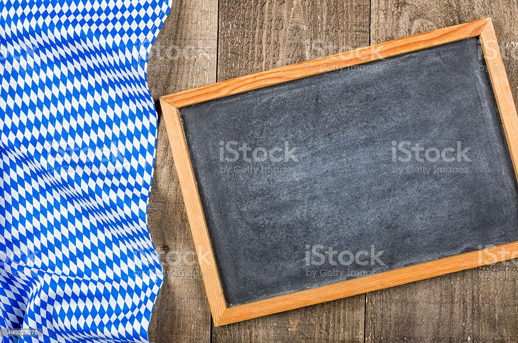 Empty blackboard with a bavarian diamond pattern stock photo