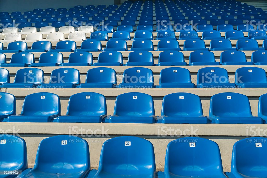 Empty bleachers - Stadium seats stock photo