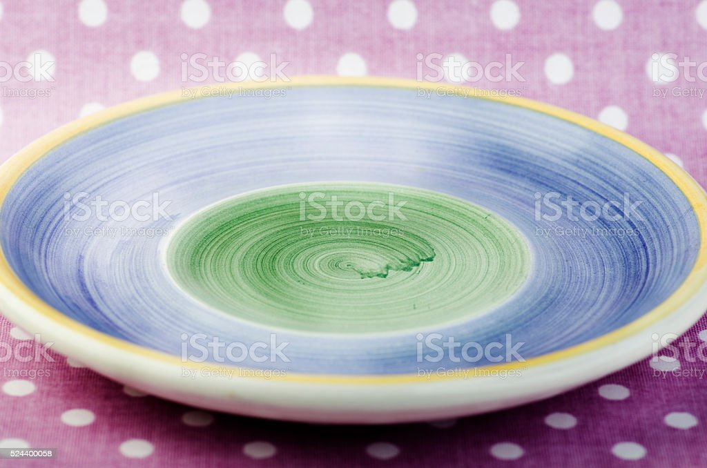 Empty blue and green plate on pink dotted background. stock photo