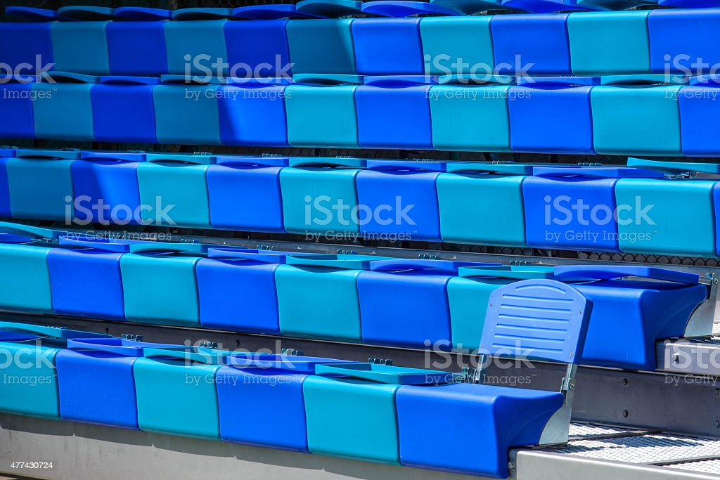 Empty blue seat,grandstands in football field stock photo