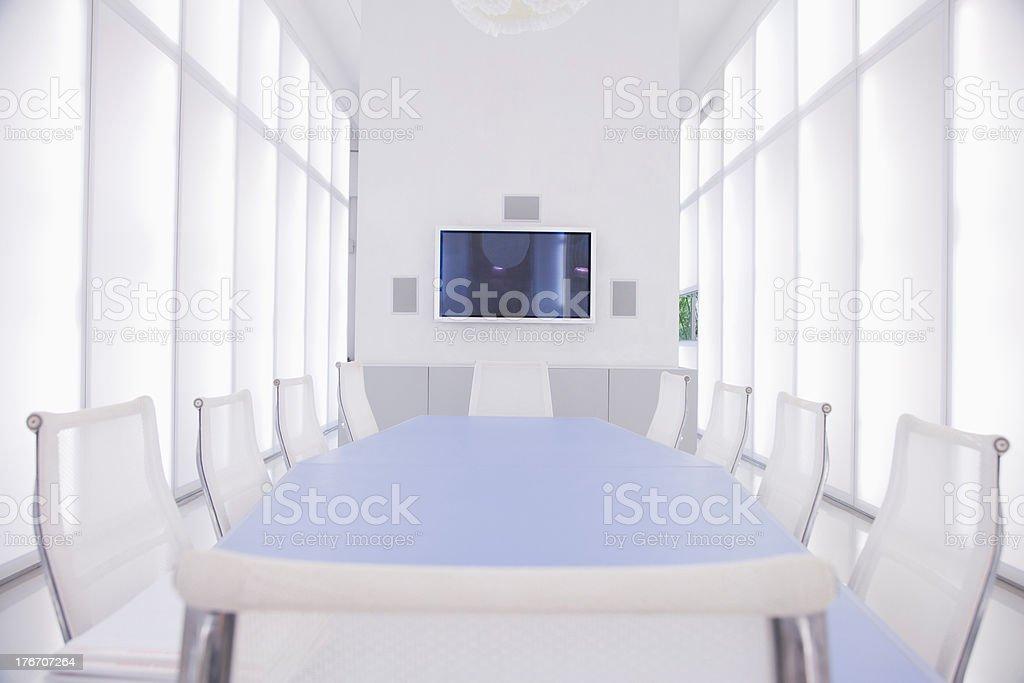 Empty boardroom with large television hanging on wall stock photo