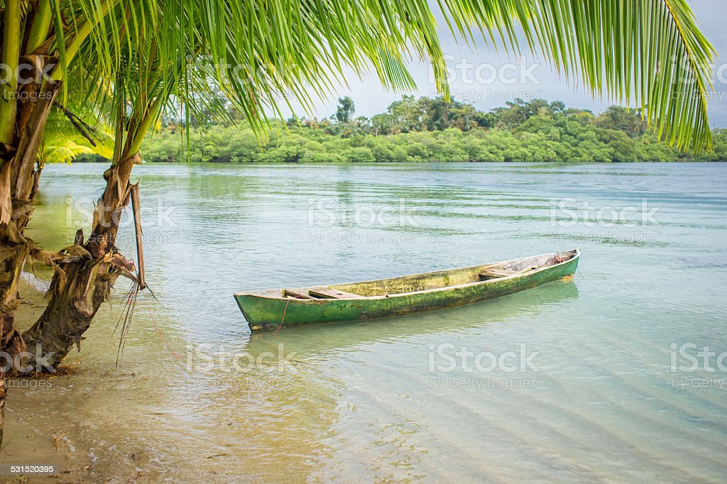Empty boat on wild beach in Bocas del Toro, Panama stock photo