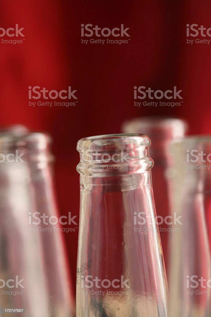 empty bottles (red background) royalty-free stock photo