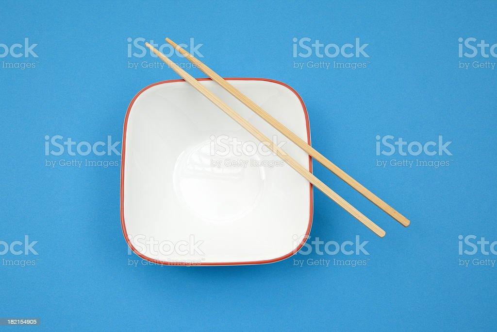 Empty Bowl with Chopsticks royalty-free stock photo