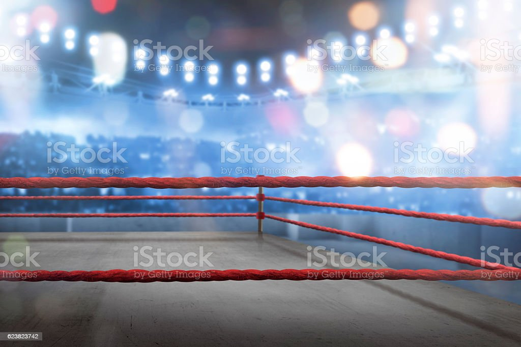 Empty boxing ring with red ropes for match stock photo