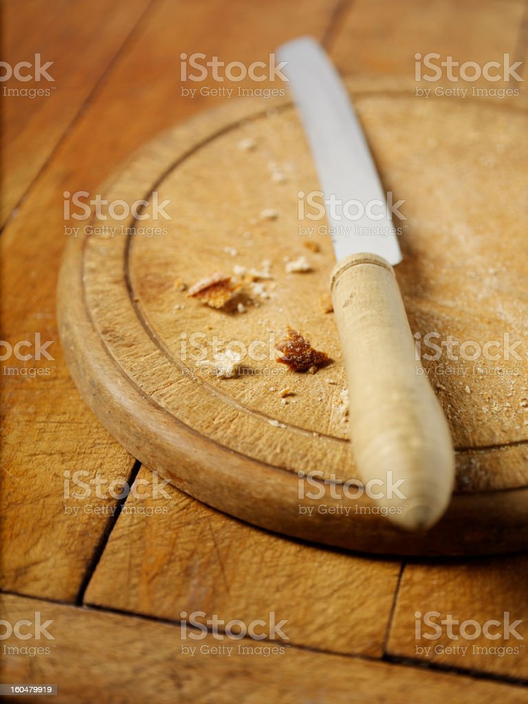 Empty Bread Board with Crumbs royalty-free stock photo