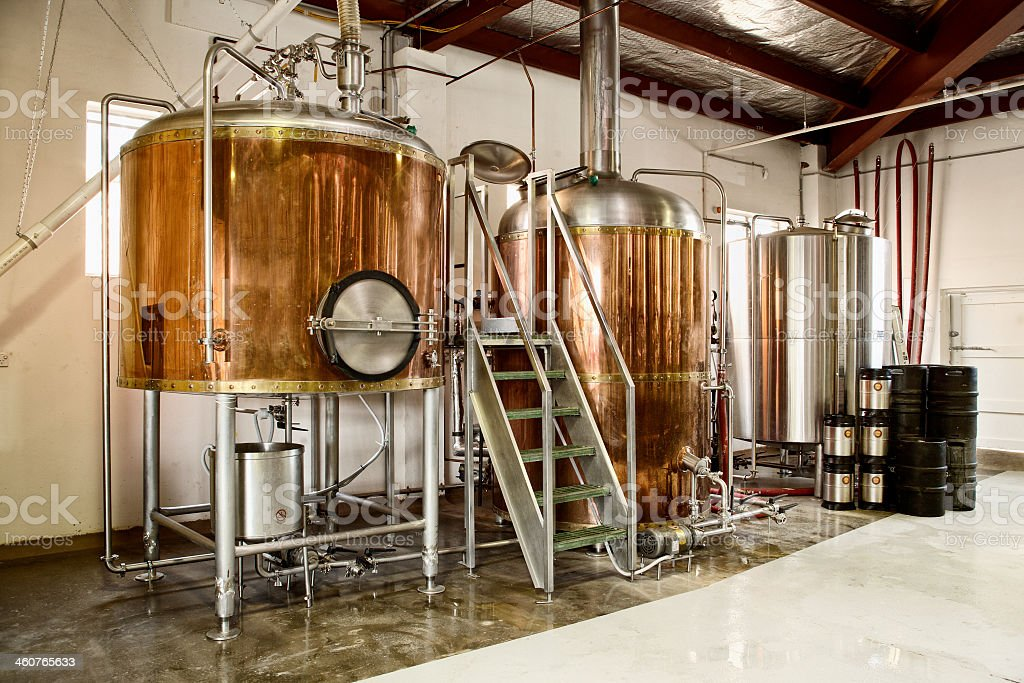 A empty brewery with large machines stock photo