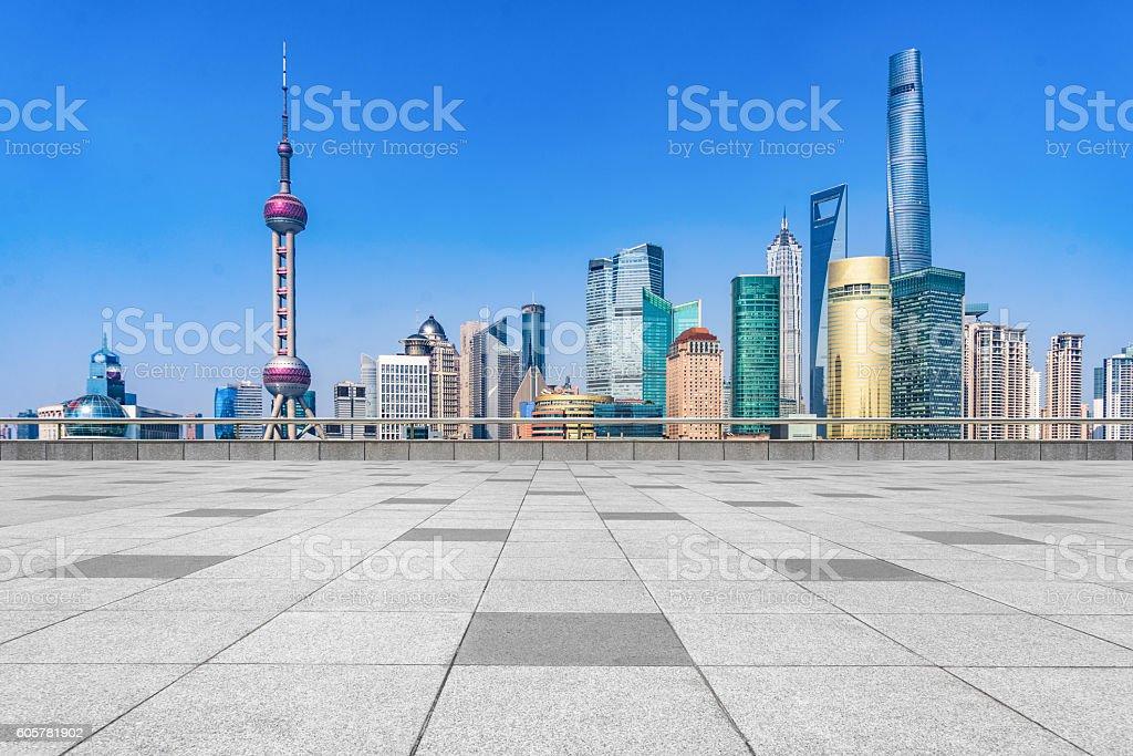 empty brick floor with city skyline background stock photo