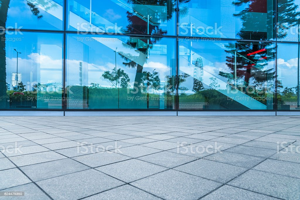 empty brick floor with glass wall pattern stock photo