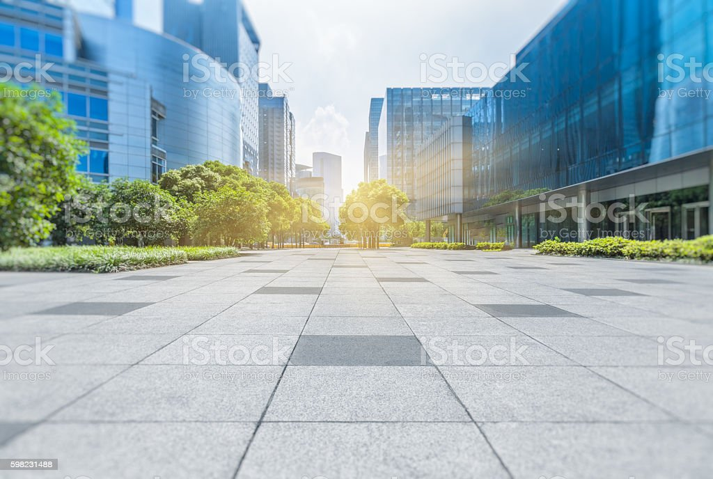 Empty brick floor with modern buildings stock photo