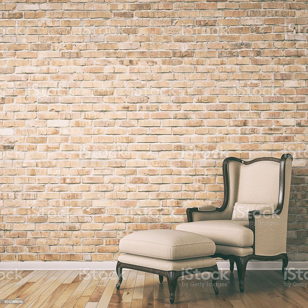 Empty brick wall behind classic chair stock photo