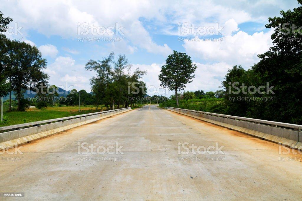 Empty bridge over river Khwae Noi stock photo