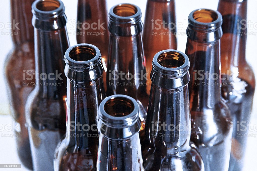 Empty Brown Beer Bottles on White Background stock photo