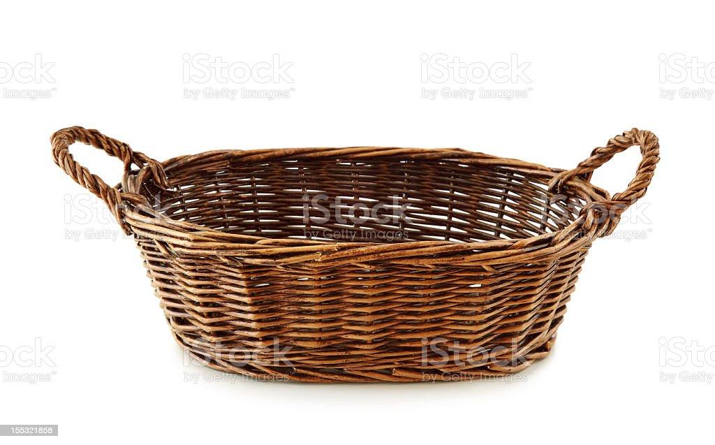 Empty brown wicker bread basket stock photo