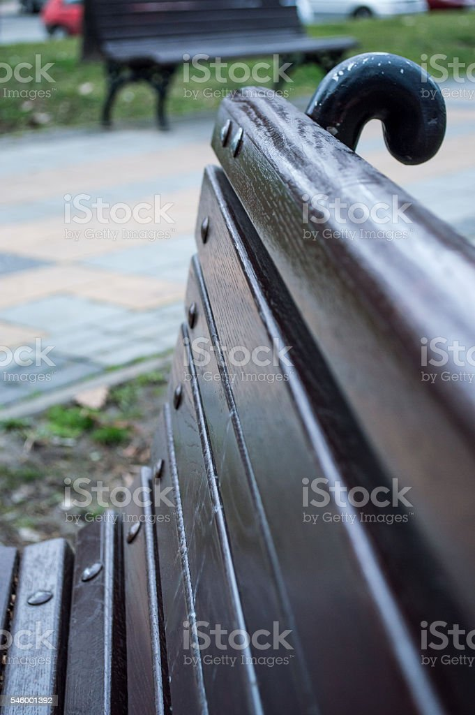 Empty Brown Wooden Park Bench Close Up royalty-free stock photo