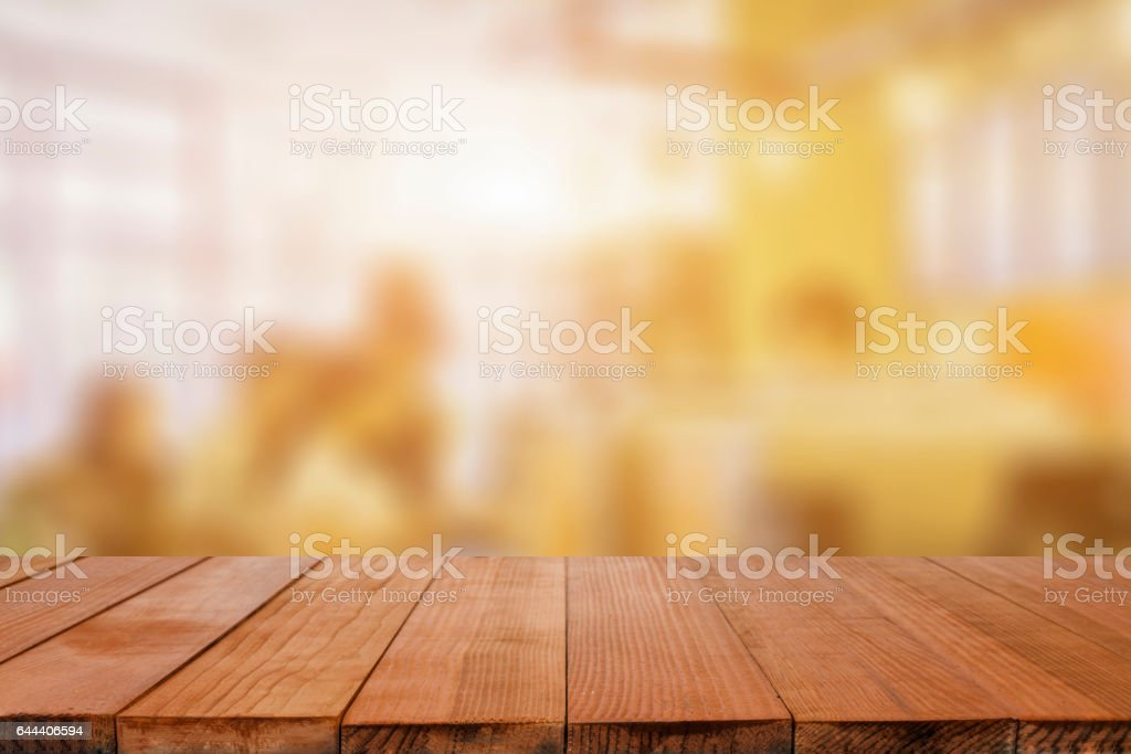 Empty brown wooden table and Coffee shop interior stock photo