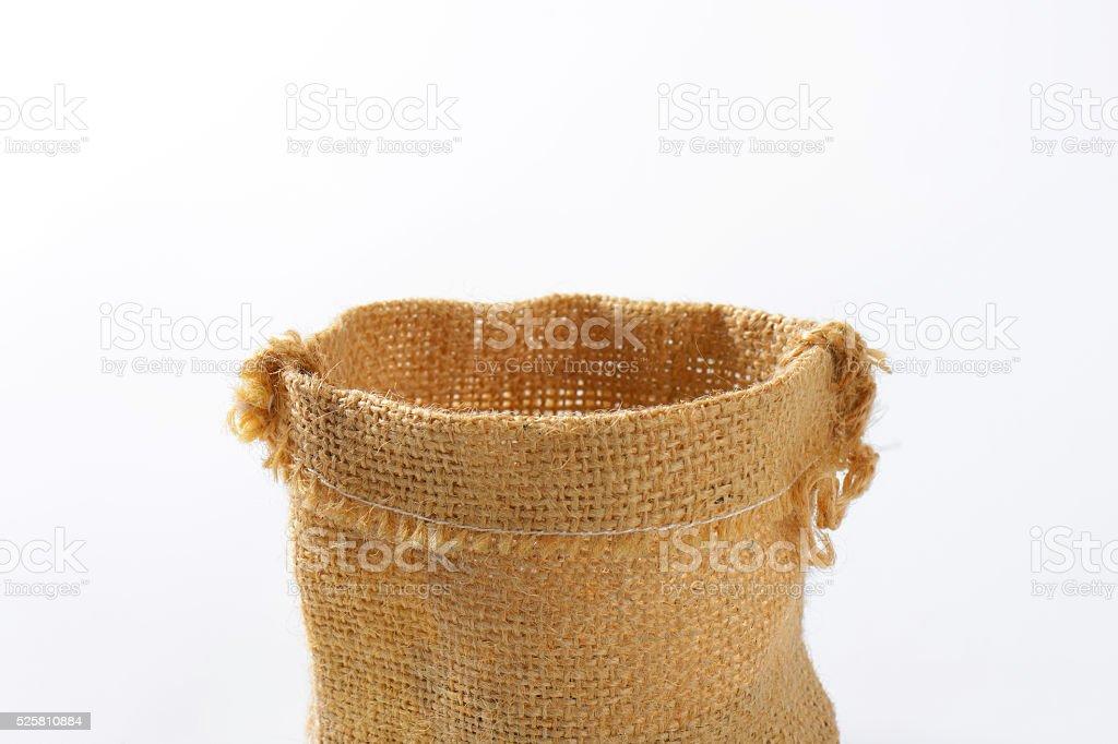 Empty burlap sack stock photo