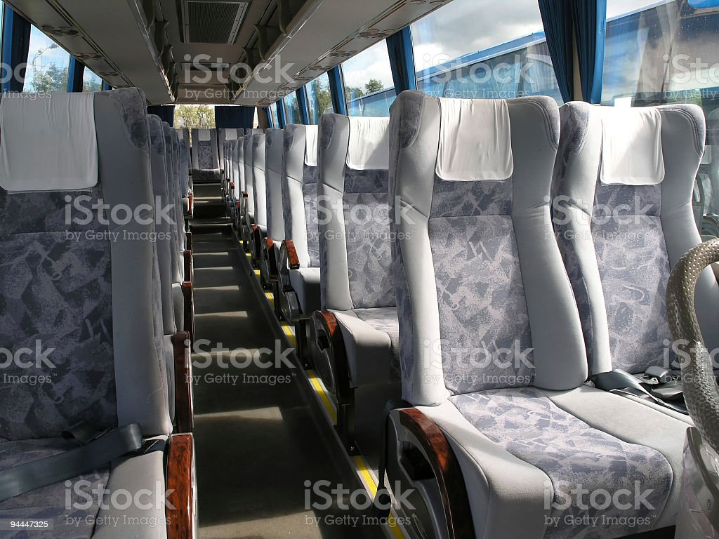 Empty bus passenger seats with seatbelt and head cloth royalty-free stock photo