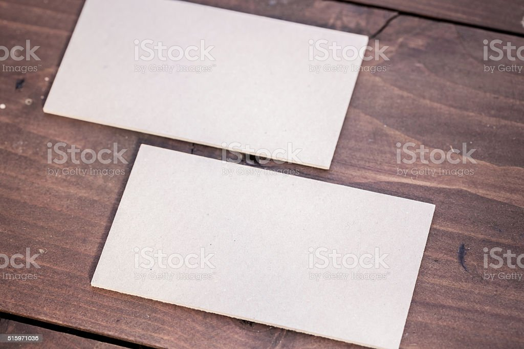 Empty Business Cards on Wooden Table stock photo