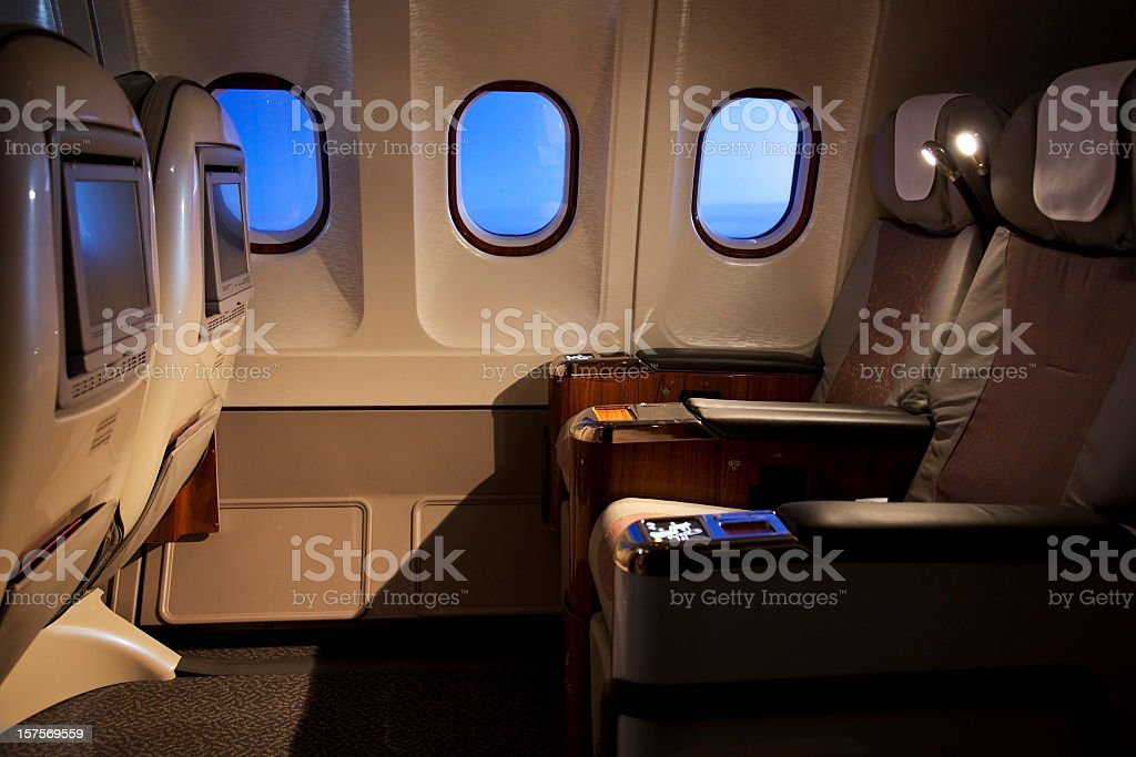 Empty business class seats in an airplane stock photo