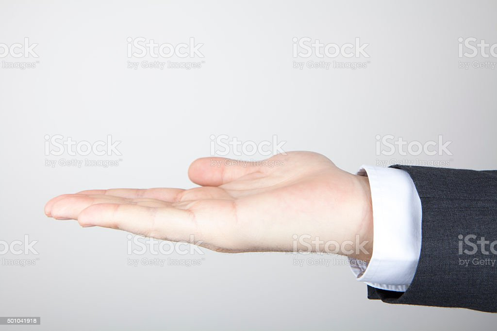 Empty businessman hand isolated on white stock photo