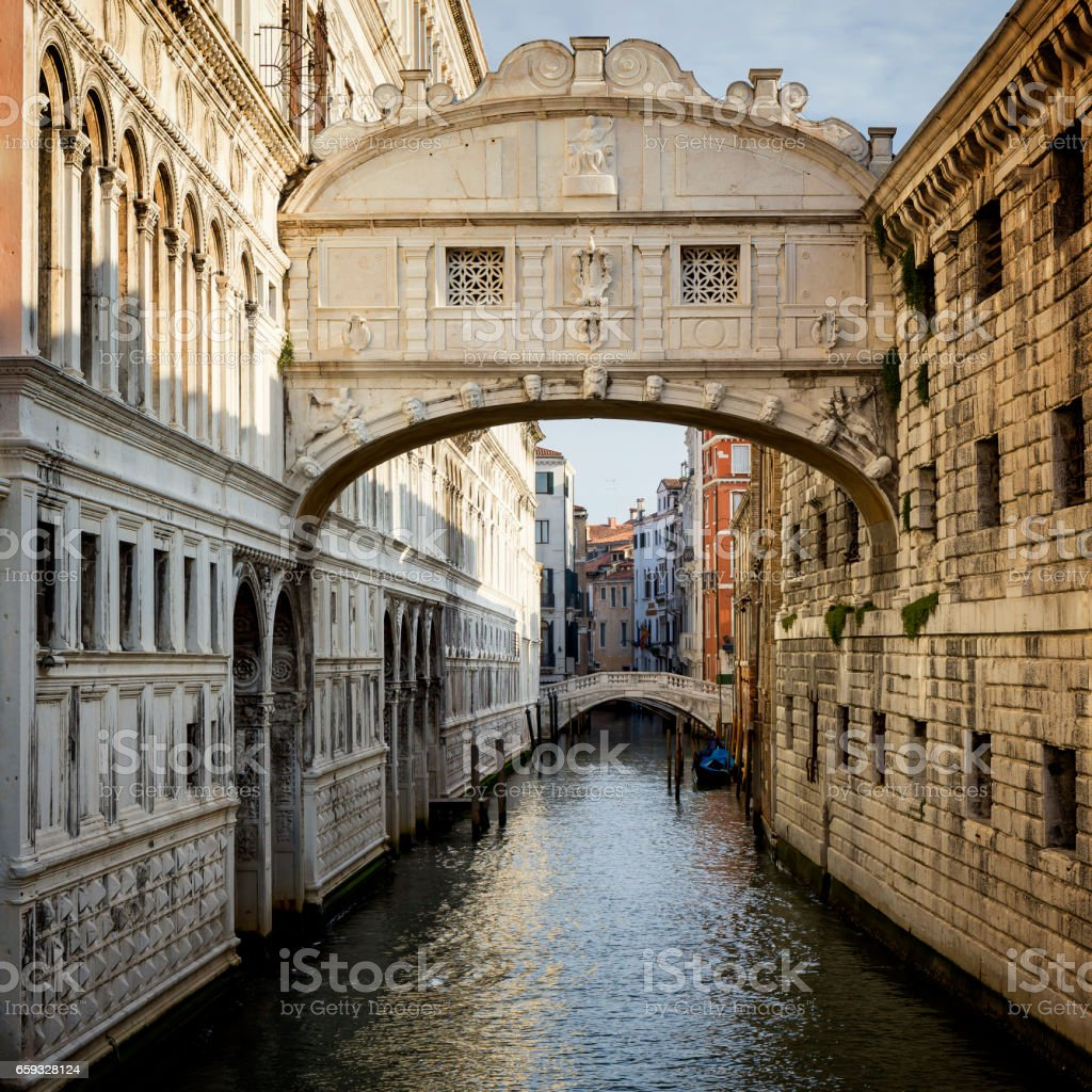 Empty canal under the Bridge of Sighs in Venice stock photo