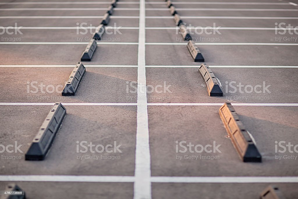 Empty car parking with white rows stock photo