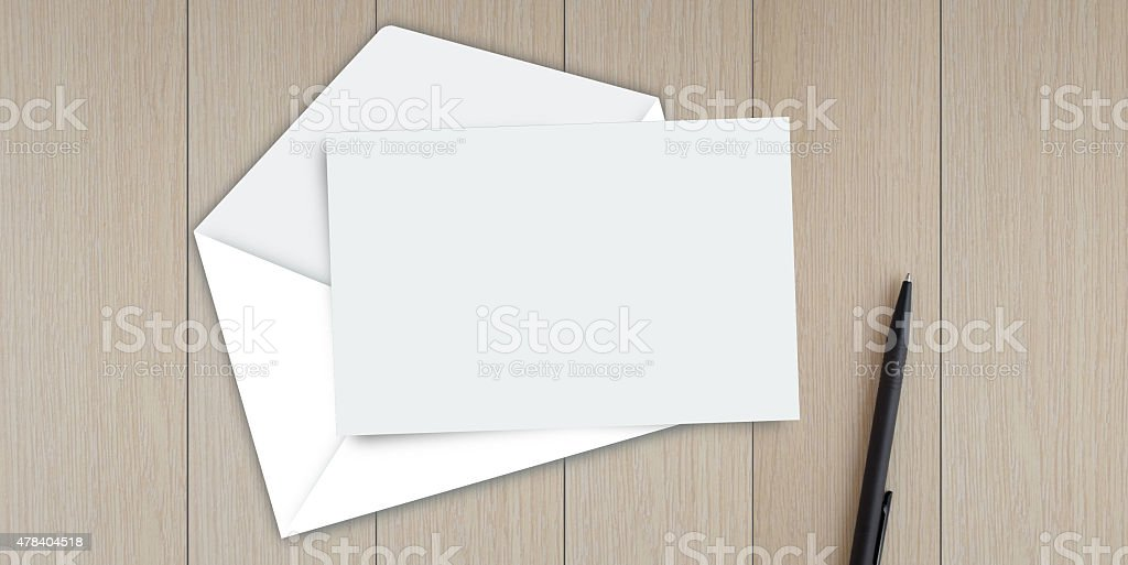 Empty card with envelope on the table stock photo