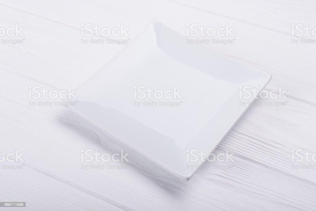 Empty ceramic plate stock photo