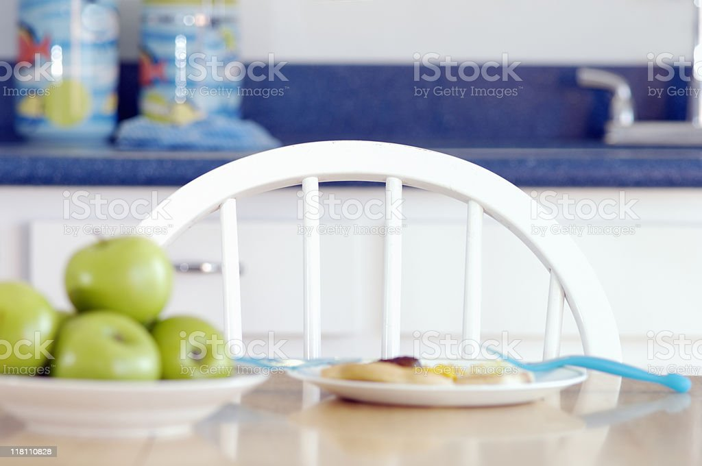Empty chair at a kitchen table royalty-free stock photo