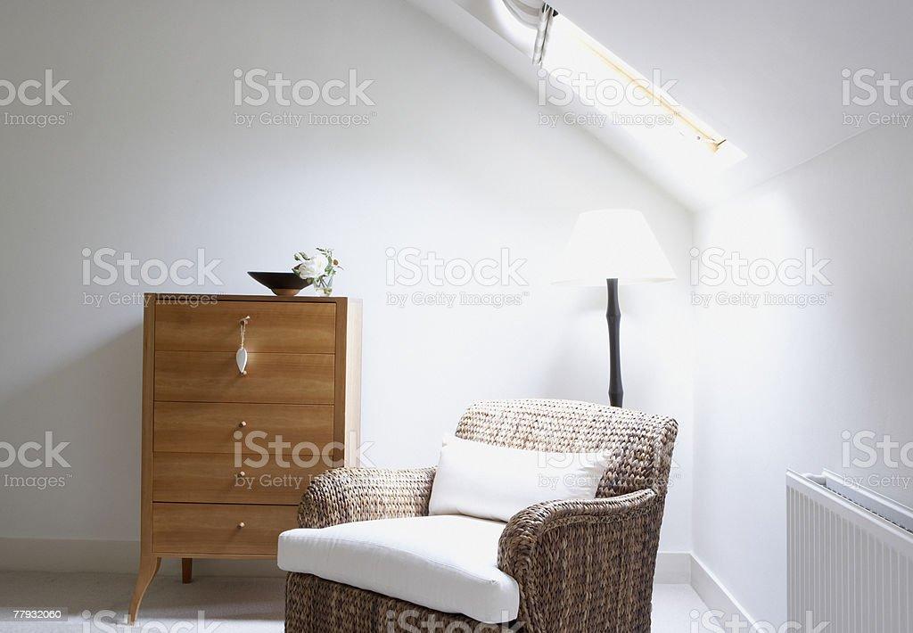 Empty chair beside dresser royalty-free stock photo