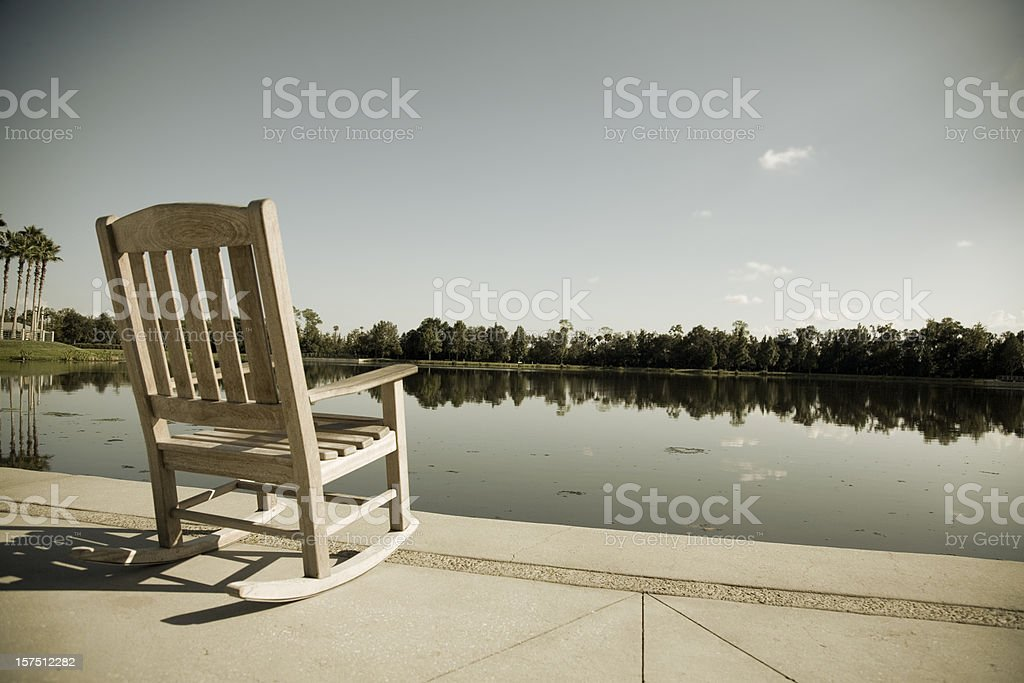 Empty Chair on a Florida Lake royalty-free stock photo