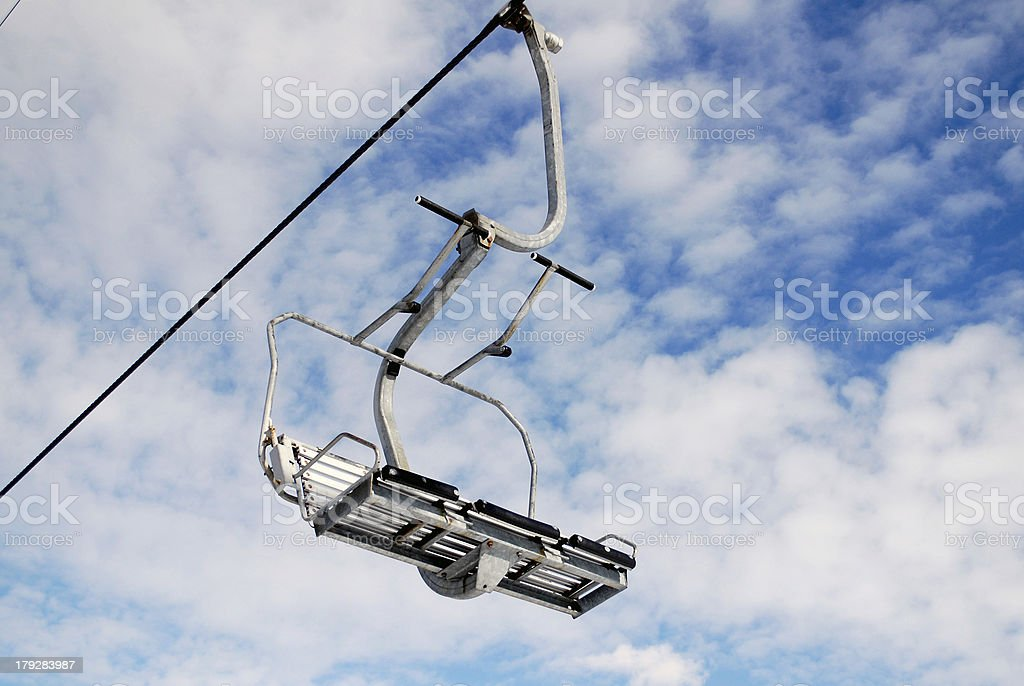 Empty chairlift on blue sky stock photo