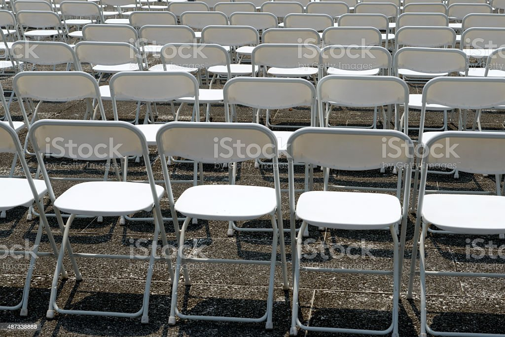 Empty Chairs and tables in outdoor area stock photo
