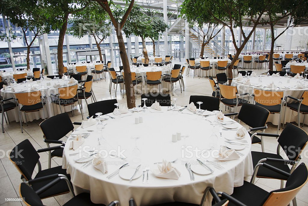 Empty chairs and tables set for luncheon stock photo