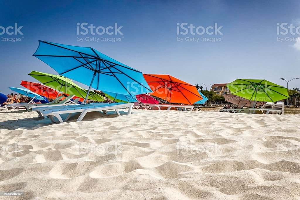 Empty chairs and umbrella at a beach in Aruba stock photo