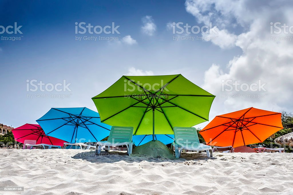 Empty chairs and umbrella at a beach in Aruba stock photo