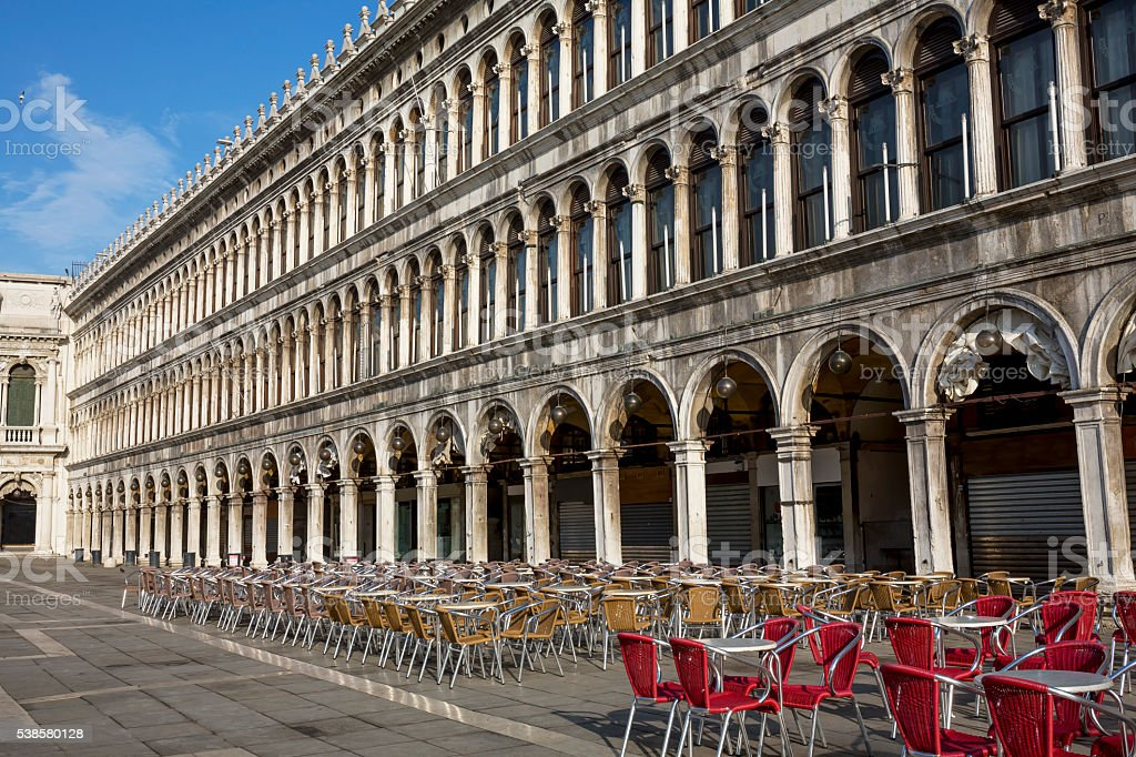 Empty chairs at St. Mark's Square in Venice stock photo